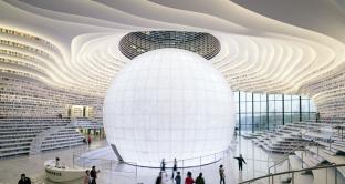 Nasce a Tianjin in Cina  la biblioteca del futuro con le sue distese di libri, sinuose e danzanti. Ecco il video.