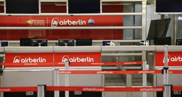 An empty Air Berlin check-in desk is seen at Tegel airport in Berlin