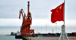 FILE PHOTO: A Chinese national flag is seen at a port in Beihai